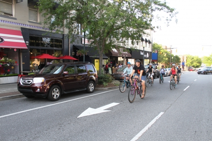 Cyclists enjoy pedaling through downtown and making stops at breweries and bottle shops. Photo courtesy Burke TDA.