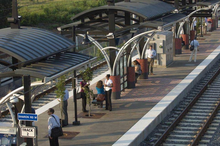 Commuters waiting at the Sharon Road West Blue Line light rail stop in Charlotte.