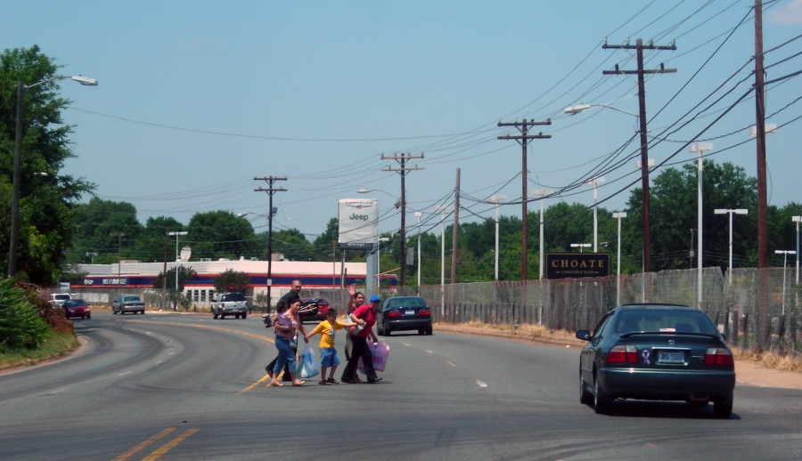 A family crossing South Boulevard in Charlotte