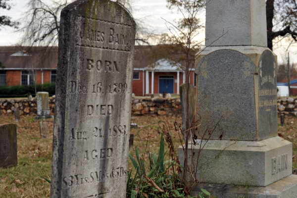 A headstone in a historic cemetery