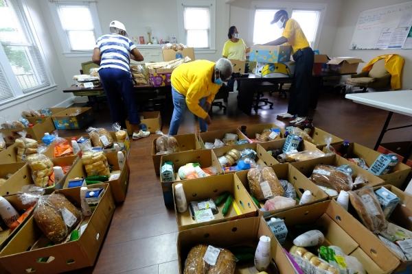 Volunteers pack food at Reeder Memorial Baptist Church in West Charlotte